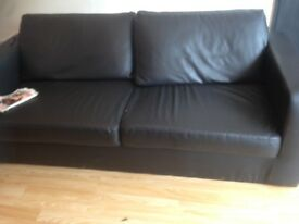 Black comfy pvc leather look sofa two seater 50 pond Ono