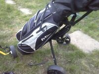 Golf bag and trolley with various clubs