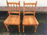 Two solid pine chairs