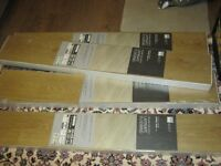 4 packs of Milano oak laminate flooring.