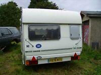 Avondale Wren small 2 berth caravan, white, good condition. Cooker, fridge, sink, lights, radio etc.