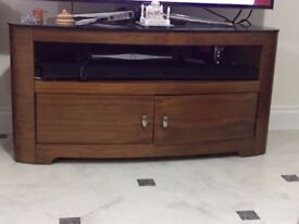 TV Cabinet in oval shape, walnut colour in great condition, nearly new.