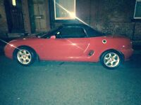 2 seater soft top lovely sports car!