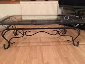 Ornamental glass coffee table
