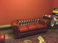 Two matching Chesterfield sofas