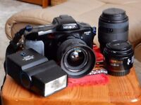 Minolta Dynax 7Xi 35mm SLR auto focus camera and with lenses and accessories