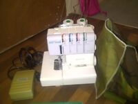 janome overlocker sewing machine with 4 new cones of white thread