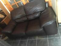 Dark brown leather two seater sofa