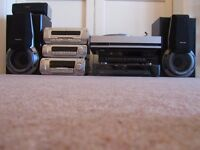 Technics stereo system with speakers, turntable , cd + vhs player