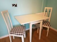 White drop leave table and 2 chairs