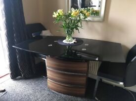 Glass top dining table wooden base