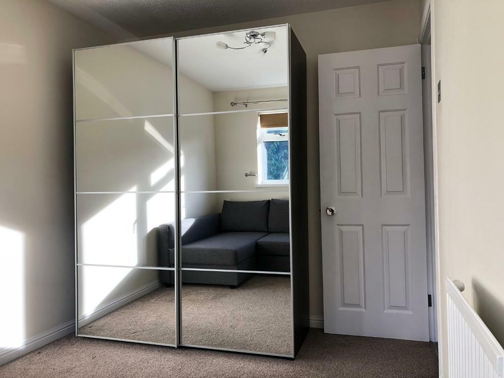 ikea pax double wardrobe with mirrored soft close sliding doors and internal drawers