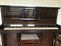 Upright overstrung piano for sale.