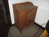 Pine computer cabinet with drawer and front opening doors.