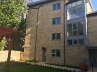 Brand new and exclusive one bedroom apartment in Clayton, Large windowed lounge with patio doors