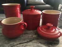 Le Crueset red stoneware jars