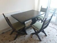 LARGE SOLID OAK DINING TABLE AND 4 CHAIRS. GREAT CONDITION. £120