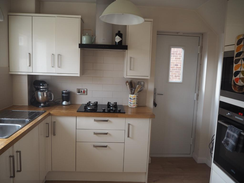 Cream Gloss Kitchen With Oak Worktops In Barnby Dun South