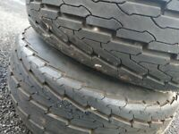 Pair of wheels 20.5x8.0.0-10 tires on galvanized rims with suspension units