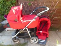 RED PRAM STROLLER WITH RAIN COVERS