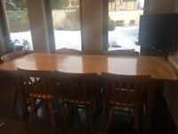 Solid wood 8 seater dining table + 8 chairs