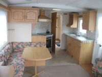 Cheap static caravan for sale on luxury leisure park INC this seasons fees/2.3k site fees/Showbar