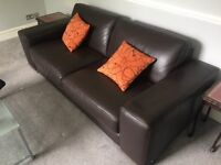 Chocolate brown faux leather sofa and armchair
