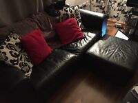Black leather sofa, footstool and chairs