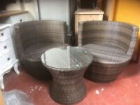 BROWN RATTAN ROUND TABLE AND 2 TUB CHAIRS