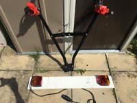 Tow bar bike rack with tow board