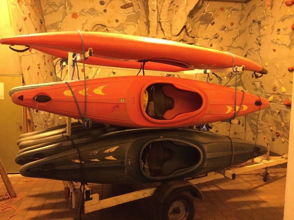 12 kayaks and trailer