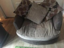 Free free free Swivel / snuggle chair with cushions