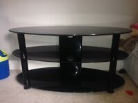 "TV stand holds up to 40"" , £20"