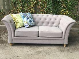 Grey button back sofa