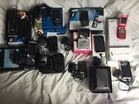 12 used mobile phones, various makes, all with chargers, some in original boxes.