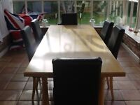Large eight seater dining table in excellent condition plus 6 leather dining chairs