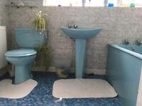 Blue ceremic bathroom sink, toilet and bath