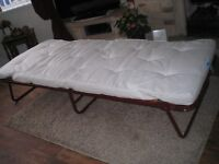 single fold up guest bed
