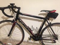 Carrera road bike size large with shoes and helmet