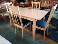 Modern dining table with 4 leather top chairs