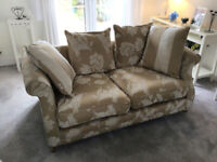 Two seater beige patterned settee