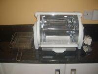 George Foreman rotisserie/roasting machine