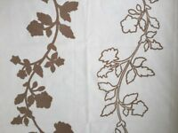 Cream curtain/upholstery fabric with beige raised leaf design