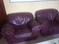 Two burgundy leather armchairs