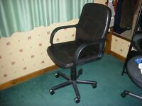 Office chair black slightly damaged but in good working order.