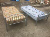 2 x single beds with mattresses £20 each. Can deliver.