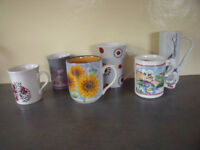 6 asst mugs - cat; goose; leopards; Ashdale sunflowers; Kiln Craft tulips; tall Johnson Bros spots.