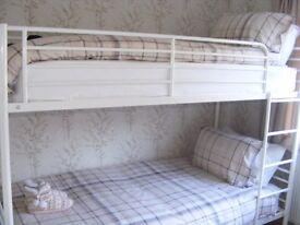 white tubular bunk beds