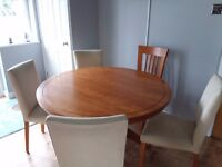 Marks and Spencer dinning room table and 5 chairs.