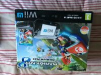 Nintendi wiiu plus extra controllers and games